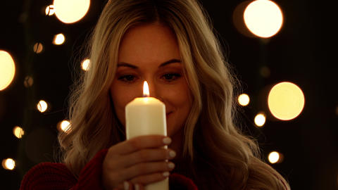 Attractive Woman Holding A Candle GIF