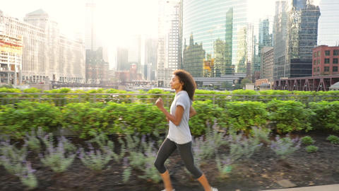 Attractive African American woman on her morning jog along the Chicago River Footage