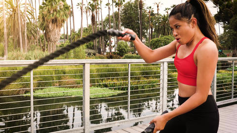 Woman working out in the park Footage