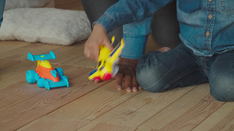 Lovely mixed race boy playing with toys at home Footage