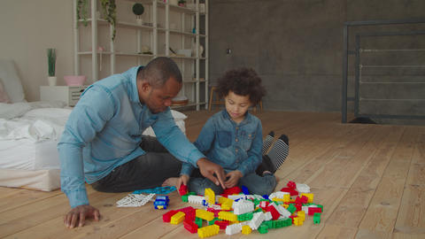 Diverse family playing with constructor at home Footage
