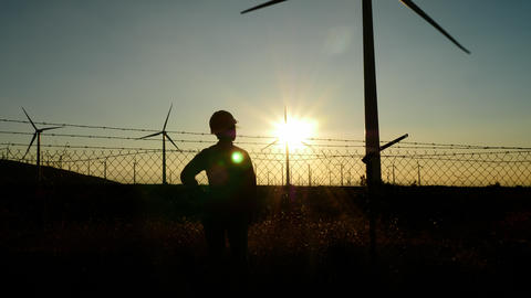 Woman engineer inspecting a wind farm in California GIF