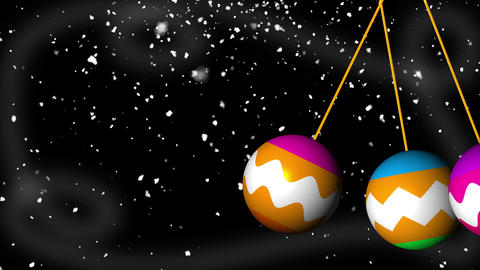 Christmas colored balls swing against the background of flickering lights Archivo