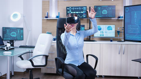 Female physician using virtual reality goggles in a futuristic clinic Live Action