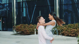 Multi-ethnic couple in love spending time together in the center of the big city Footage