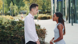Mixed-race woman starts crying during the quarrel with her boyfriend in the Footage