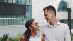 Close-up of cheerful multiracial couple in love kissing each other on date Footage