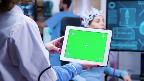 Female doctor looking at tablet green screen in a modern facility for neurology Footage