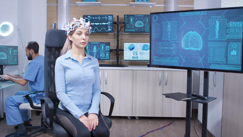 Neuro science female doctor and her assistant in modern facility Live Action