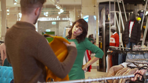 Man offers his girlfriend a sweater but she refuses Footage