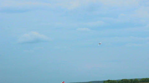 Airplane showing tricks in sky on the air show. Nice aircraft model performance Footage