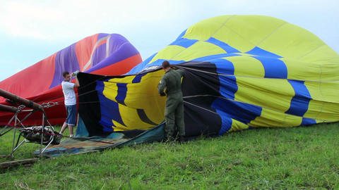 Hot air balloon blowing before taking off Footage