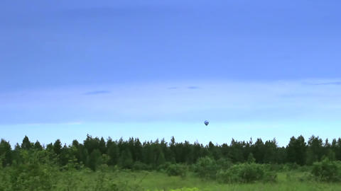 Hot air balloon landing in blue sky time-lapse Footage