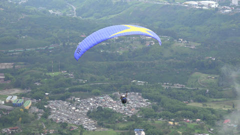 Parasailing Over Mountain Range Footage