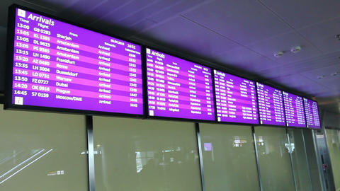 Flight arrivals and departures info screens on screen monitor in airport lobby Live Action