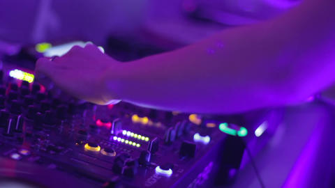 Female Dj hands playing set in night club party Footage