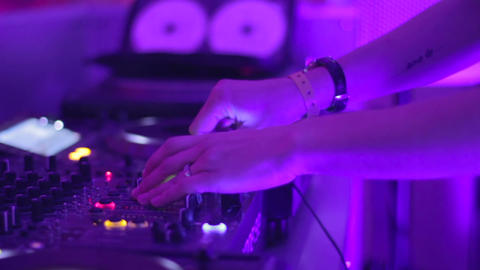 Young woman DJ in night club performs her set Footage