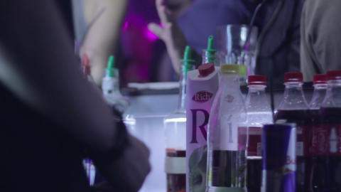 Serving alcohol drinks for visitors in night club Footage