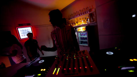 Young female DJ silhouette at night club during her set Footage