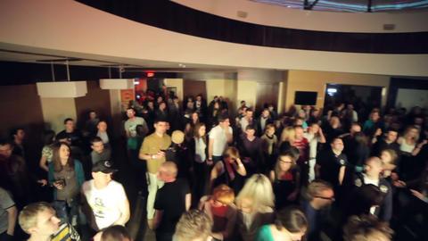 Beautiful splashes on dancefloor jib crane overhead shot at night club party Footage