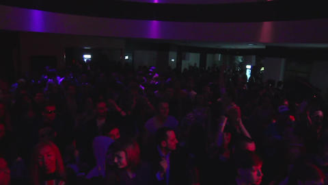 Slow motion crowd overhead shot in night club at disco music party Footage