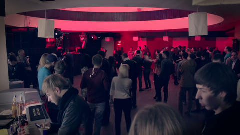 Time lapse of clubbing people coming to night club. Crowd flocks to nightclub Live Action