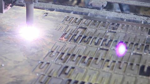 Plasma laser cutting process, metal plate being cut Footage