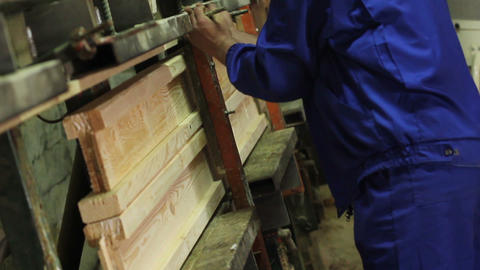 Pressing and forming of wood form work yellow covering Live Action