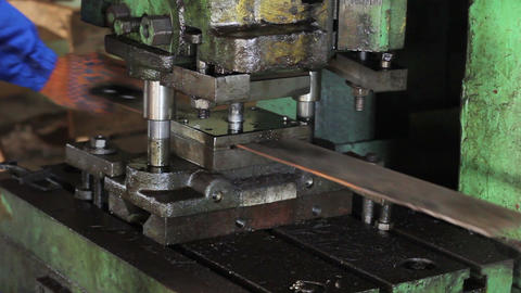 Stamping holes in iron bar machine process Footage