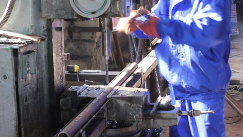 Drilling holes in steel bar girder at factory construction site Live Action