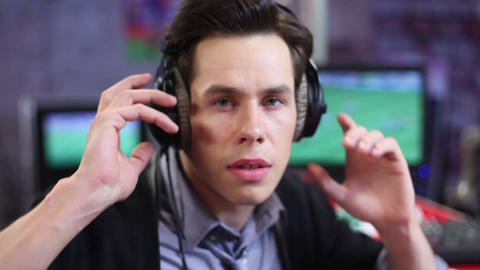 Man stunned with surprise. Amazed soccer commentator takes headphones off Footage