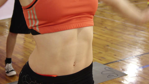 Breathing exercise in gym, female abs contracted and relaxed. Muscles close up Footage