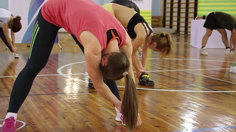 Body stretching in gym by group of people. Indoor sportsmen fitness training Footage