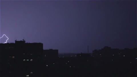 Large wide lightning bolt strikes night city, sounds of rain and thunder Footage