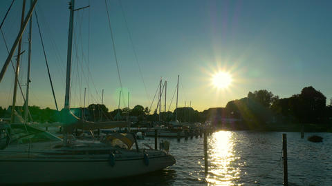 Sailboat harbor sunset - Sailing, sail, ship, boat in marina. Baltic Sea Footage