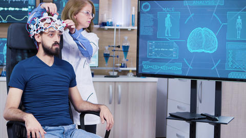 Male patient in modern technology on his head for reading brain activity ビデオ