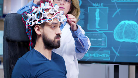 Side view of patient wearing brains headset with sensors ビデオ