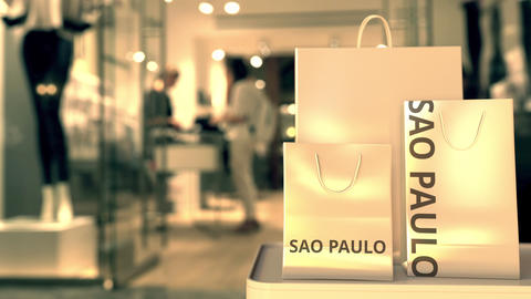 Shopping bags with SAO PAULO text against blurred store. Brazilian shopping GIF