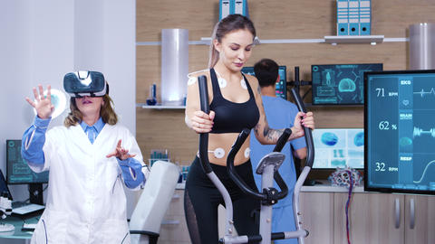 Female doctor in sport scienese wearing virtual reality goggles Footage