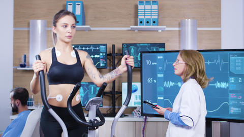 Female doctor in sport science testing woman athlete endurance Footage
