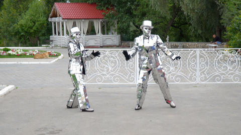 Men in mirrored suits and hats dance in front of the camera Footage