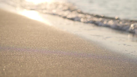 Waves of Mediterranean Sea rolling in sunshine to the sandy beach. Beautiful Footage