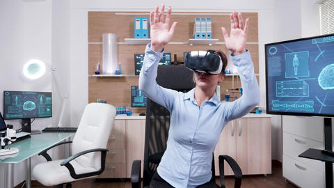 Female scientist in a research laboratory using virtual reality goggles Footage