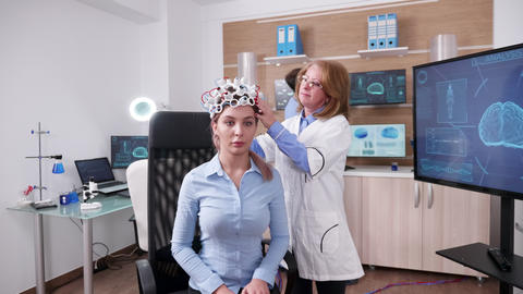 Female scientist in a neuroscience facilty with a patient Footage