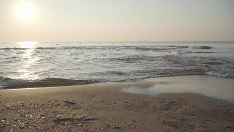 Timelapse of crystal clear Mediterranean waves crashing on the sandy beach Footage