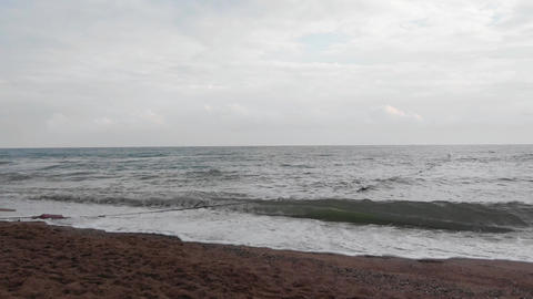Camera approaching evening waves of Mediterranean Sea crashing on the sandy Footage