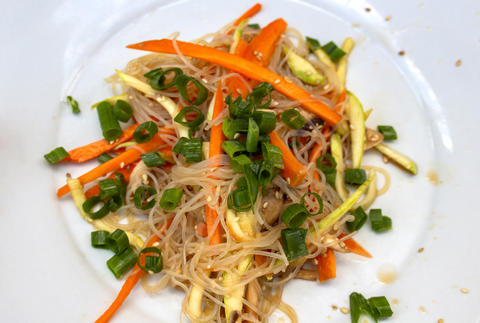 Portion vegetable salad with noodles Photo