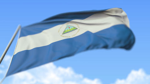 Waving national flag of Nicaragua, low angle view. Loopable realistic slow Live Action
