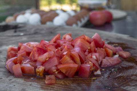 Cut pink tomatoes on a wooden board Photo