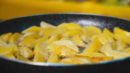Potatoes Fried in oil. Cooking fried potatoes ビデオ